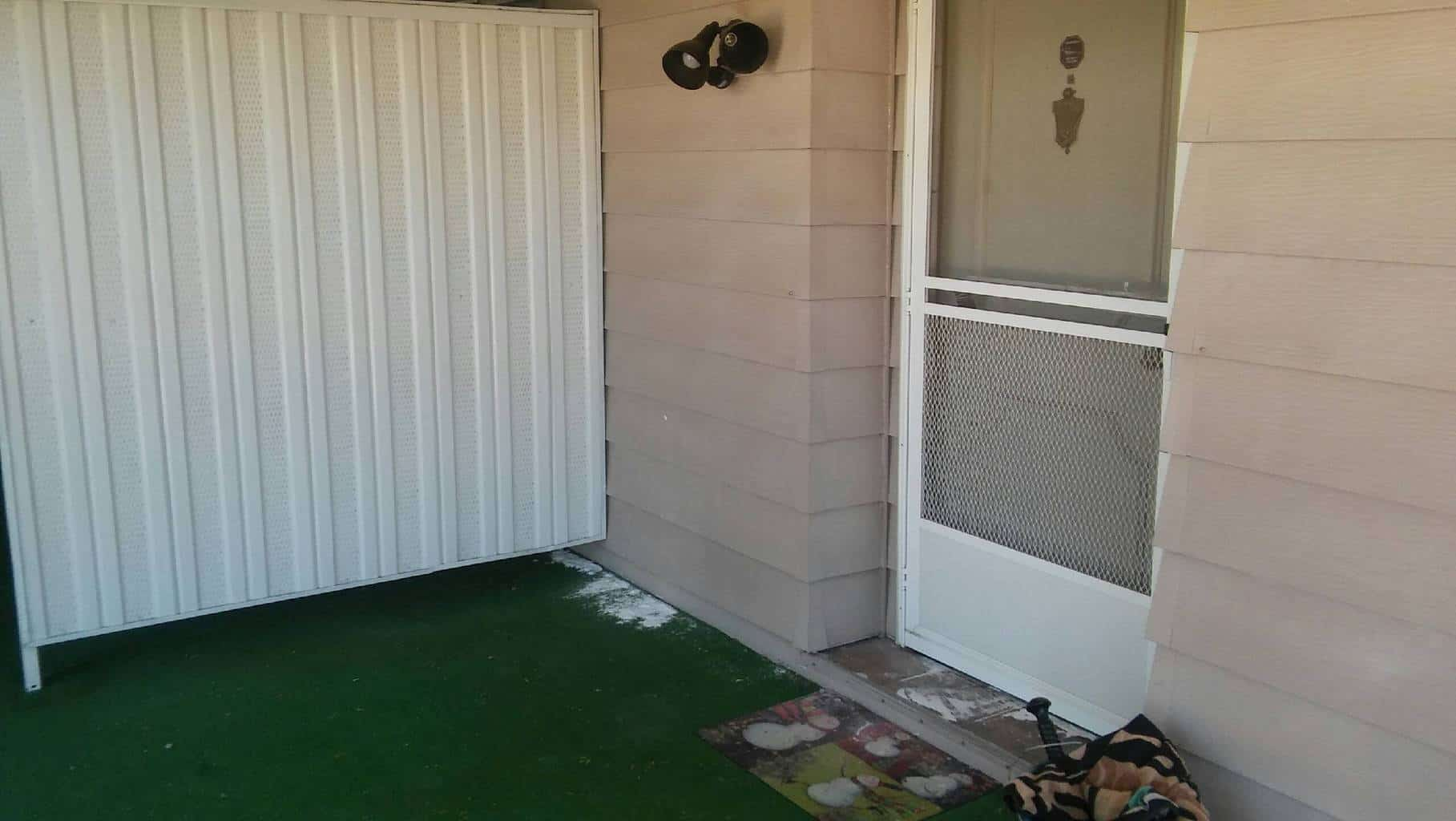 Front door of a single wide mobile home that we loaned on.